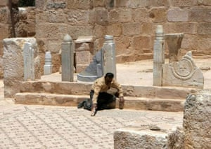 worker cleans the mosaic of the oldest church in the world, in the town of Rehab
