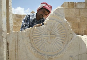 Worker cleans a section of the oldest church in the world in the town of Rehab