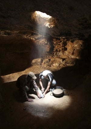 Workers excavate inside a cave that is part of the oldest church in the world in the town of Rehab