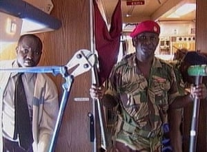 Zimbabwe military officials hold up wire cutters in this video frame grab in Harare