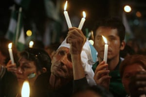 Residents, holding up candles, demonstrate during the closing campaign rally in support of a provincial referendum for autonomy