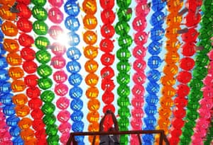 A Buddhist follower hangs name tags of those who donated money and lotus lanterns at Chogye Temple