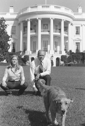 1974: President Gerald Ford and his daughter Susan sit on the White House lawn watching Liberty, a golden retriever, given to the president by his daughter