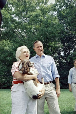 1988: Vice President George  Bush and his wife Barbara holding the family dog