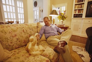 2000: George Bush teases his cat Ernie while at the Governor's Mansion in Austin, Texas
