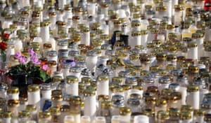 Kauhajoki, Finland: Candles are laid outside the Kauhajoki vocational high school. A masked gunman killed ten people before shooting himself