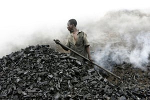 Duekoue, Ivory Coast: A man works in a traditional charcoal factory