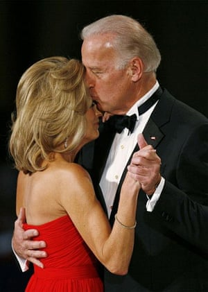 US Vice-president Joe Biden kisses his wife Jill as they dance at the Commander-In-Chief Ball in Washington
