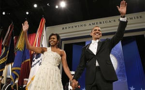 President Barack Obama and first lady Michelle Obama wave to attendees