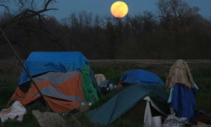 A full moon rises over Tent City