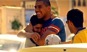 Ajami, men hugging