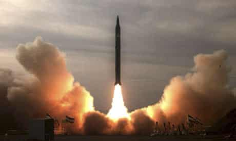 A long-range, Sejil 2 missile is test-fired in the desert at an unknown location in Iran