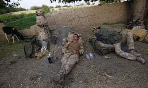 British soldiers sleep in a makeshift compound in Helmand province