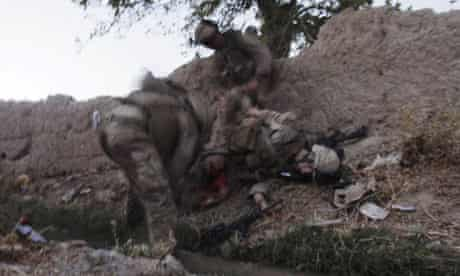 Lance Cpl. Joshua Bernard is tended to by fellow U.S. Marines in Afghanistan
