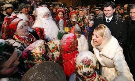 Prime Minister Yulia Tymoshenko greets people during the Orthodox Christmas celebrations