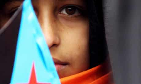 A protester holds a South Yemen flag during a demonstration outside 10 Downing Street