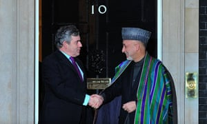 Gordon Brown greets Afghan president Hamid Karzai ahead of a meeting in 10 Downing Street