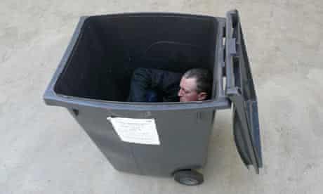 Michael Landy in a bin