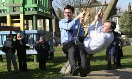 Ministers Andy Burnham and Ed Balls in a playground
