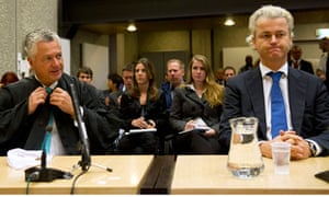 Dutch politician Geert Wilders sitting in court in Amsterdam with his lawyer Bram Moszkowicz