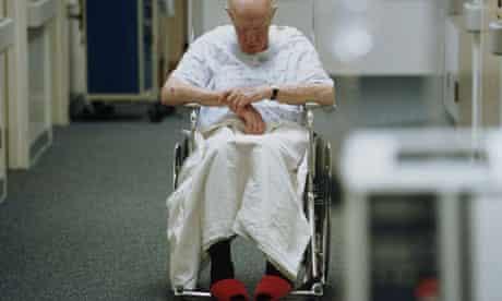 Elderly patient in a wheelchair on a hospital ward