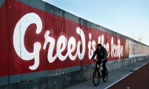 A man cycles past a sign in Dublin
