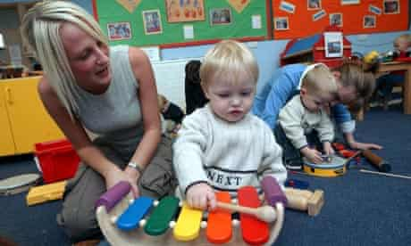 Mother with child at a Sure Start children's centre