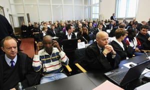 accused somali men and lawyers in courtroom