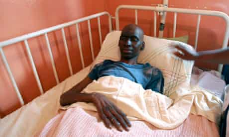 Male Aids patient in a hospital bed