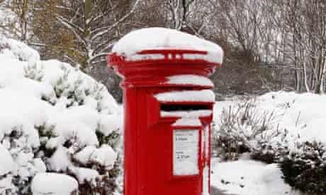 snow-covered royal mail post box