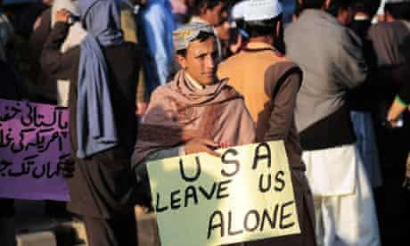 Pakistani boy with placard saying 'USA leave us alone'