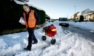 a postman delivering mail in the snow