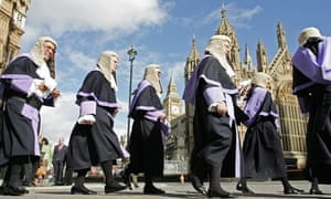 Judges wearing wigs and robes