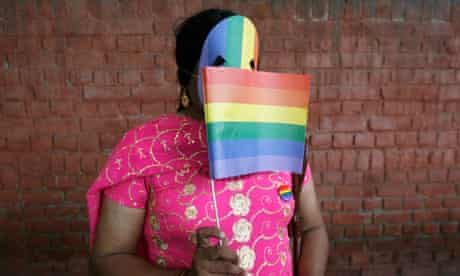 """A gay rights activist displays a rainbow flag during """"Queer Pride March"""" in New Delhi"""