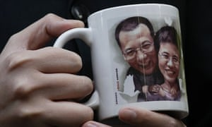 Mug featuring image of jailed Chinese dissident Liu Xiaobo and his wife Liu Xia