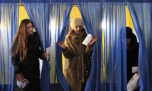Ukrainian women leave a voting booth