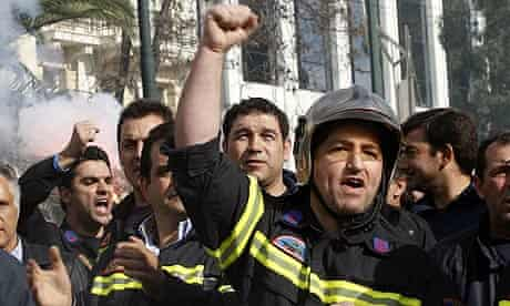 Firefighters protest outside the Greek Parliament against planned spending cuts