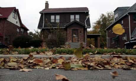 Fallen leaves blow past an empty home in Detroit