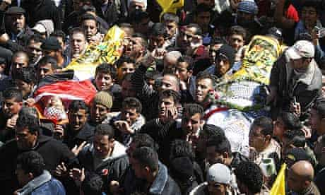 Palestinian mourners carry the bodies of Mohammad Qadus and Osaid Qadus.