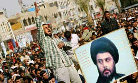 An Iraqi supporter of Moqtada al-Sadr shouts during Friday prayer service