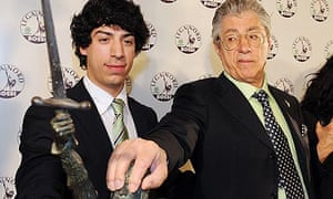 Leader of the Italian Northern League, Umberto Bossi (r), and his son Renzo in their HQ in Milan.