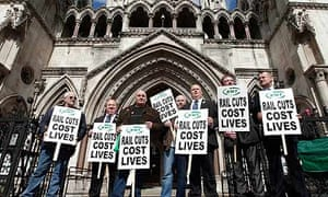 Rail Maritime and Transport (RMT) union supporters protest in front of the high court