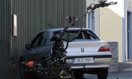 A bomb disposal robot examines a suspected car bomb