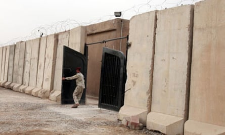 Iraqi soldier closes gate at a Baghdad prison