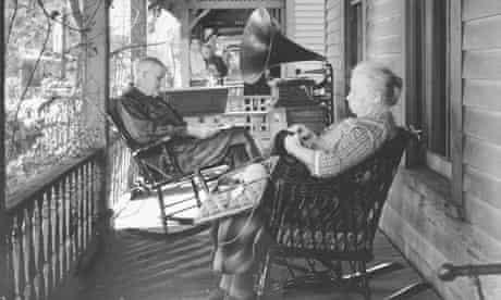 Elderly couple sitting on porch in rocki