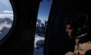 An airman looks for wreckage the day after a plan crashed over the Salang Pass in Afghanistan.