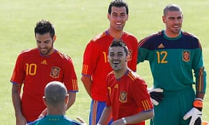 Spain's national soccer team players joke before posing for an official portrait in Las Rozas