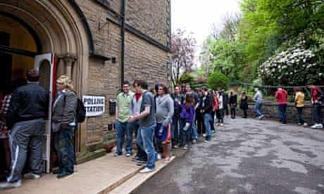 Voters queue outside a polling station in the Sheffield Hallam constituency.