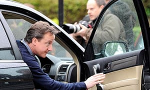 David Cameron leaves his home in west London.
