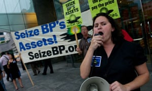 Activists with the group Seize BP hold a